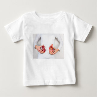 Hands holding model of human kidney organ at body. baby T-Shirt