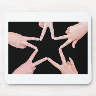 Hands of girls making star shape on black mouse pad