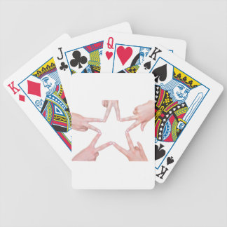 Hands of girls making star shape on white bicycle playing cards