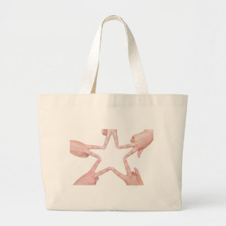 Hands of girls making star shape on white large tote bag