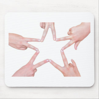 Hands of girls making star shape on white mouse pad