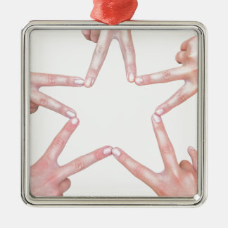 Hands of girls making star shape on white Silver-Colored square ornament