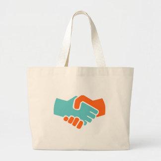 Handshake together large tote bag