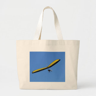 Hang glider in the sky large tote bag