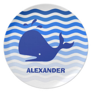 Happy blue whale swimming in blue waves plates