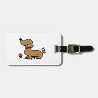 Happy dog wanting to play luggage tag