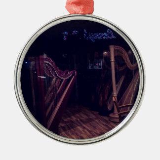 Harps in shadow metal ornament