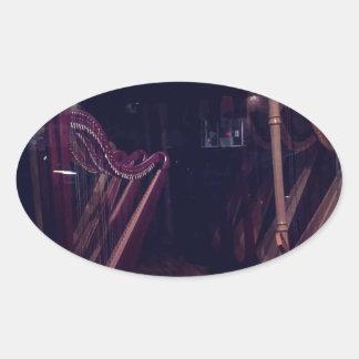 Harps in shadow oval sticker