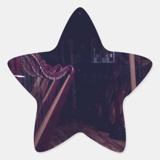 Harps in shadow star sticker