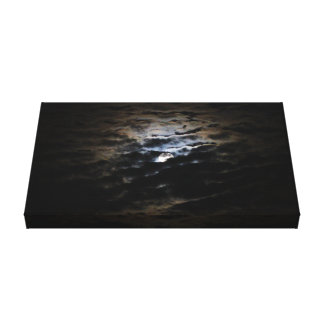 Harvest Moon with dramatic clouds Canvas Print