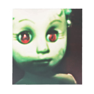 haunted red eyed doll products notepad