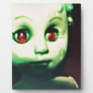 haunted red eyed doll products plaque