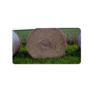 Hay bale rolls in a green field personalized address label