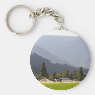 Hayfield irrigation in the mountains of BC Basic Round Button Keychain