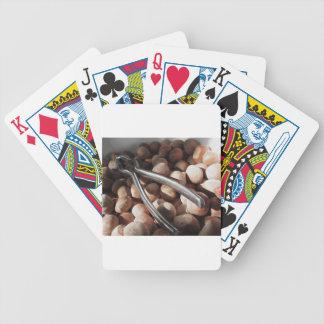 Hazelnuts in bowl with metal nutcracker poker deck