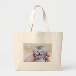 Head newborn silver tabby cat sleeping on hand large tote bag