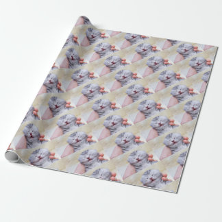Head newborn silver tabby cat sleeping on hand wrapping paper