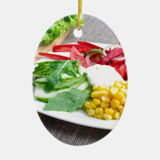 Healthy dish made from natural  ingridients ceramic oval ornament