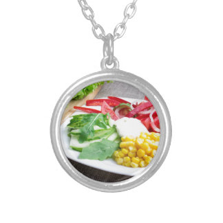 Healthy dish made from natural  ingridients silver plated necklace