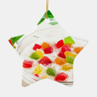Healthy oatmeal close-up with candied fruit ceramic star ornament