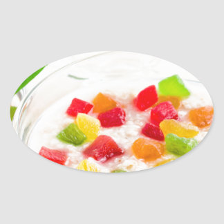 Healthy oatmeal close-up with candied fruit oval sticker