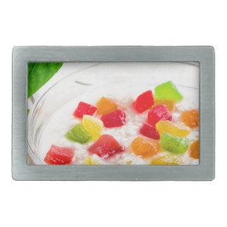 Healthy oatmeal close-up with candied fruit rectangular belt buckle