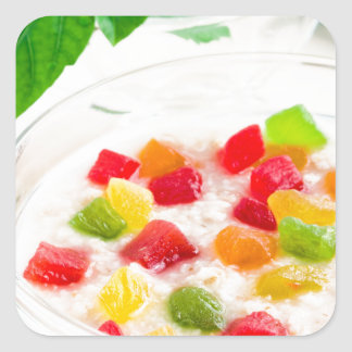 Healthy oatmeal close-up with candied fruit square sticker