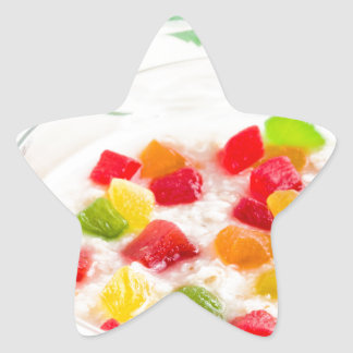 Healthy oatmeal close-up with candied fruit star sticker