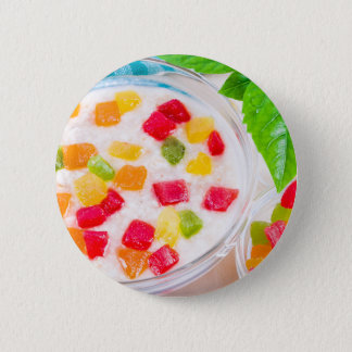 Healthy oatmeal close-up with colorful candied 2 inch round button