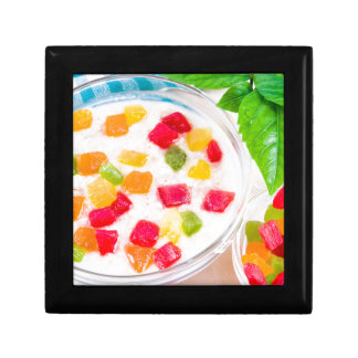 Healthy oatmeal close-up with colorful candied gift box