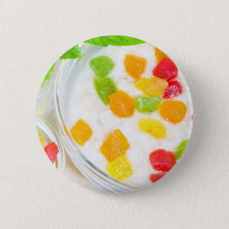 Healthy oatmeal close-up with colorful fruits 2 inch round button
