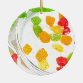 Healthy oatmeal close-up with colorful fruits round ceramic ornament