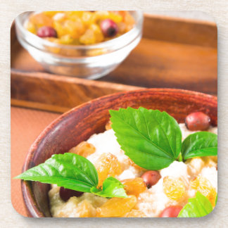 Healthy oatmeal with berries, raisins and herbs coaster