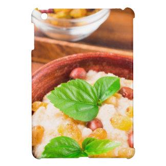 Healthy oatmeal with berries, raisins and herbs iPad mini covers