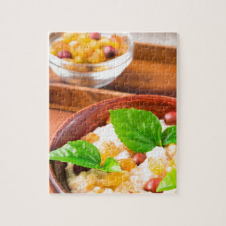 Healthy oatmeal with berries, raisins and herbs jigsaw puzzle