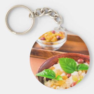 Healthy oatmeal with berries, raisins and herbs keychain