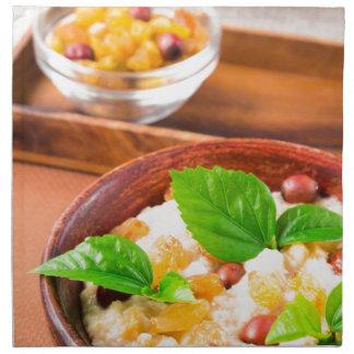 Healthy oatmeal with berries, raisins and herbs printed napkin