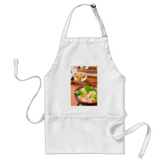 Healthy oatmeal with berries, raisins and herbs standard apron