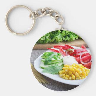Healthy vegetarian dish of fresh vegetables basic round button keychain