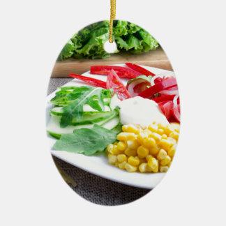 Healthy vegetarian dish of fresh vegetables ceramic oval ornament