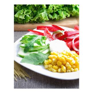 Healthy vegetarian dish of fresh vegetables letterhead