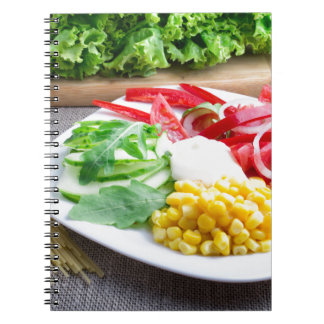 Healthy vegetarian dish of fresh vegetables notebooks