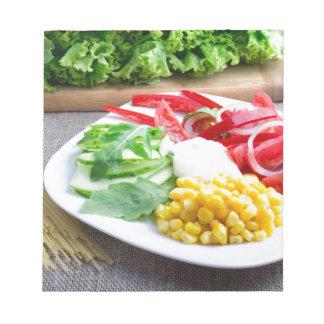 Healthy vegetarian dish of fresh vegetables notepad