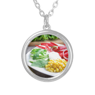 Healthy vegetarian dish of fresh vegetables silver plated necklace