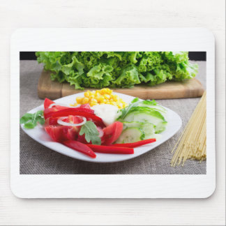 Healthy vegetarian dish on a gray textured fabric mouse pad