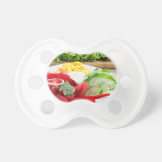Healthy vegetarian dish on a gray textured fabric pacifiers