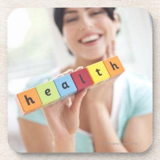 Healthy young woman, conceptual image. coaster