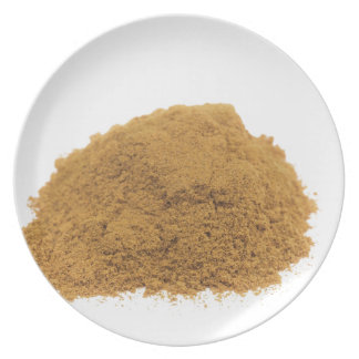 Heap of cinnamon powder on white background dinner plates