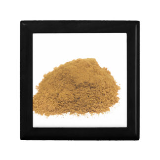 Heap of cinnamon powder on white background gift box