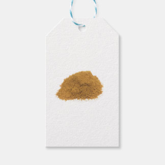 Heap of cinnamon powder on white background pack of gift tags